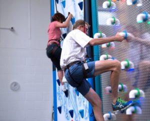 Clip n Climb Cambridge two climbers scaling a Cambridge indoor climing wall